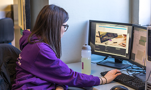 A female student working at a computer station