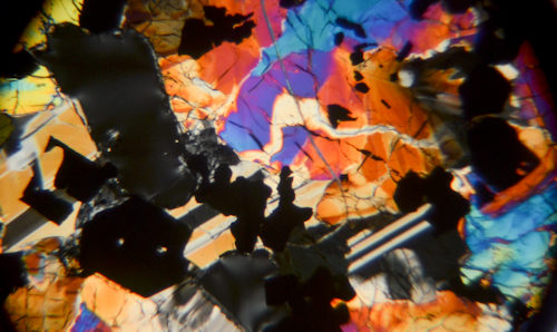 Colourful rock sample viewed under a microscope
