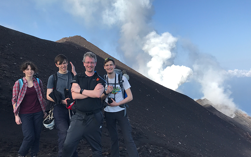 Students posing on a volcano